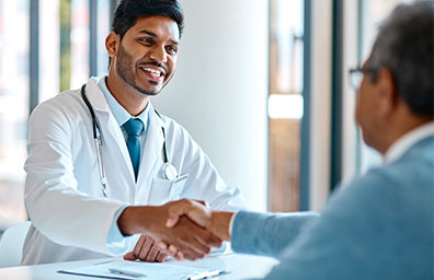 a doctor shaking hands with a patient