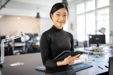 oung businesswoman standing in office