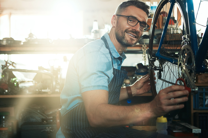 man working in a bicycle repair shop