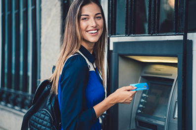 Smiling woman at the ATM